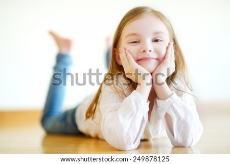 Portrait of a cute little girl at home - stock photo