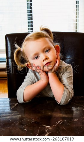 Portrait of a cute little girl. Childhood, gesture and people. - stock photo