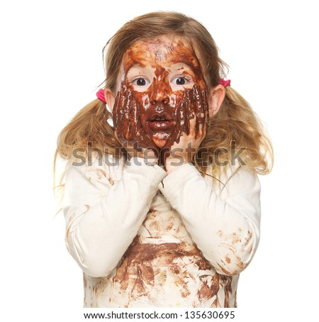 Portrait of a cute little girl covered in brown chocolate - stock photo