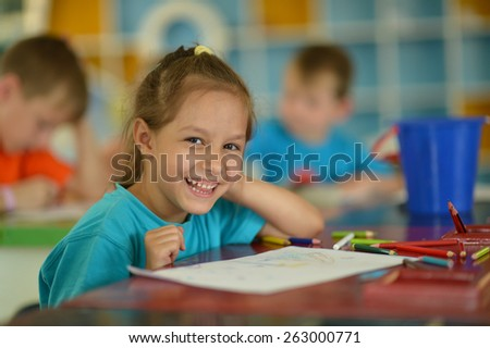 Portrait of a cute Little girl drawing - stock photo