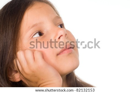 portrait of a cute little girl dreaming - stock photo