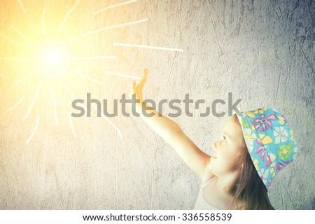 Portrait of a cute little girl in a hat - stock photo