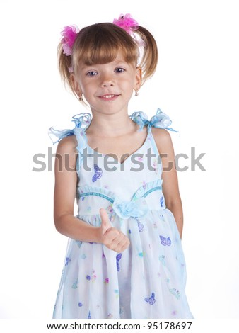 Portrait of a cute little girl in blue dress on the white