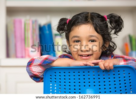 Portrait of a Cute Little Girl in the Classroom - stock photo