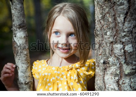 Portrait of a cute little girl outside