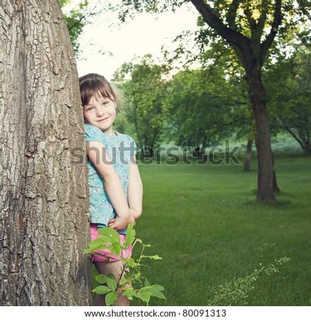 Portrait of a cute little girl outside - stock photo