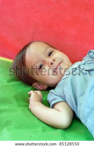 portrait of a cute little girl playing outside - stock photo