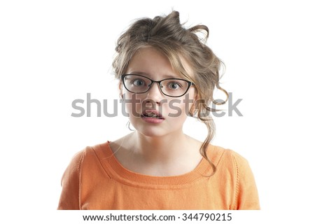 Portrait of a cute little girl puzzled. Studio photography on a white background. Age of child 10 years. - stock photo
