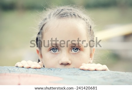 Portrait of a cute little girl with blue eyes - stock photo