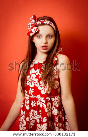Portrait of a cute little girl with confused expression  - stock photo