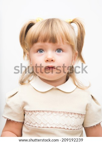 Portrait of a cute little girl with pigtails - stock photo