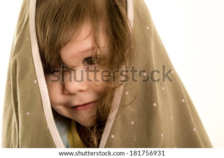 Portrait of a cute little girl with towel on her head