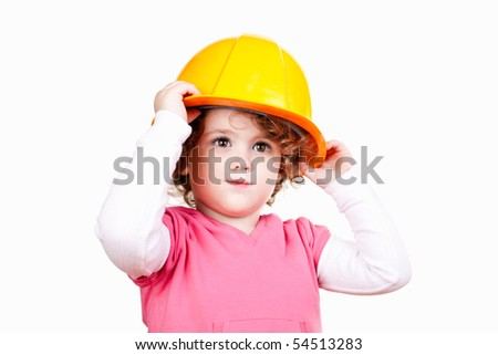 portrait of a cute little girl with yellow helmet on her head - stock photo