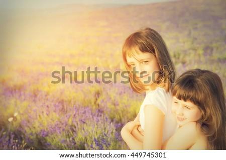 Portrait of a cute little girsl in a lavender field - stock photo
