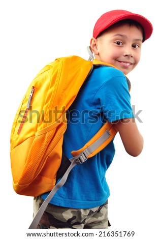Portrait of a cute little schoolchild with backpack and a cap. Isolated over white background. - stock photo