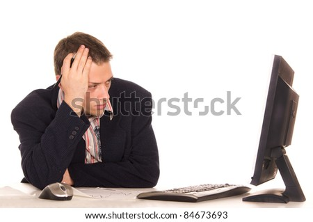 portrait of a cute man at computer - stock photo