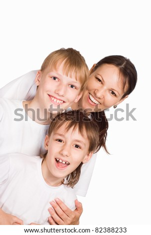 portrait of a cute mom with her sons on white