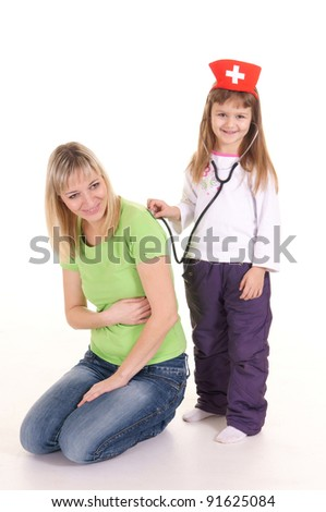 portrait of a cute mom with little nurse - stock photo