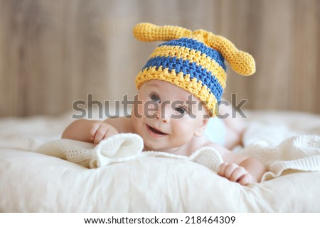 Portrait of a cute 4 months baby lying down on a blanket - stock photo