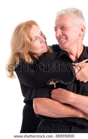 portrait of a cute old couple posing on white