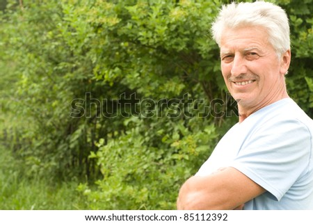 portrait of a cute old man at nature