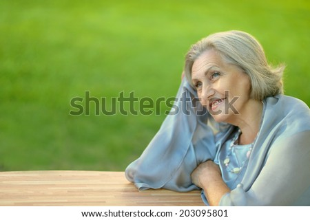 Portrait of a cute old woman outdoors