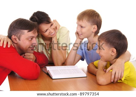 portrait of a cute parents reading with sons