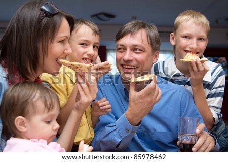 portrait of a cute people eating pizza - stock photo