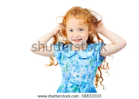 Portrait of a cute red-haired girl. Isolated over white background. - stock photo