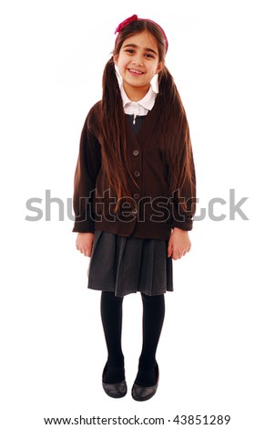 Portrait of a cute schoolgirl isolated on white