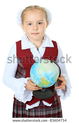 Portrait of a cute schoolgirl with a globe. Isolated over white background.