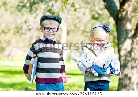 Portrait of a cute smart boy and girl. Education.   - stock photo