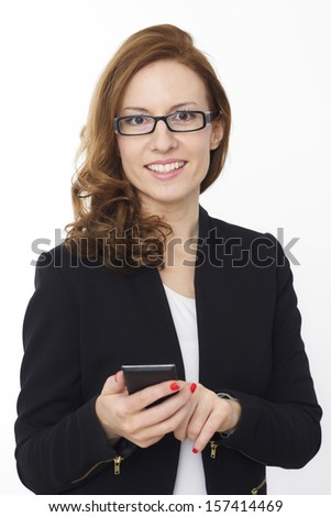 Portrait of a cute smiling business female holding a cell phone on white background - stock photo