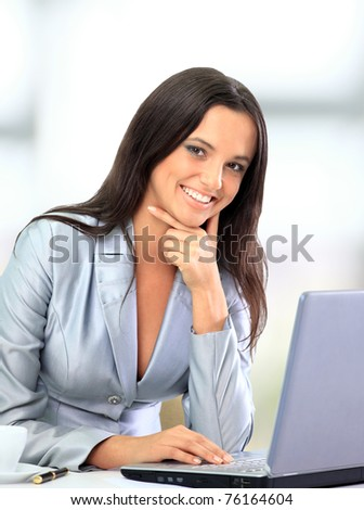Portrait of a cute smiling businesswoman working on a laptop