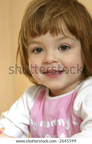 portrait of a cute, smiling happily, child