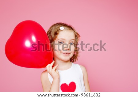 Portrait of a cute smiling preschool girl with a red balloon, over pink - stock photo