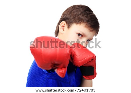 Portrait of a cute sporty boy in boxing gloves. Isolated over white background. - stock photo