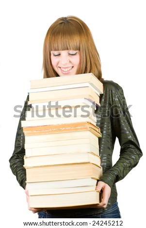 Portrait of a cute student or librarian holding a stack of books