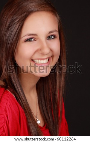 portrait of a cute teen girl, red shirt, black background - stock photo
