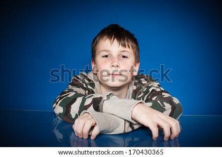 portrait of a cute teen on blue background
