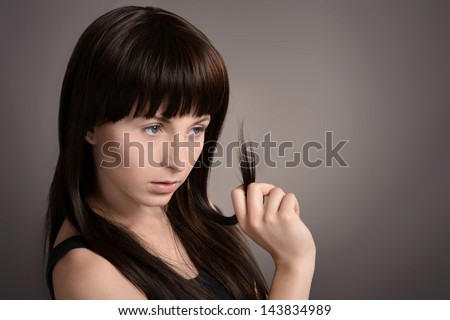 portrait of a cute teenage girl on a gray background - stock photo