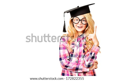 Portrait of a cute ten years girl in big round spectacles and academic hat. Isolated over white. - stock photo
