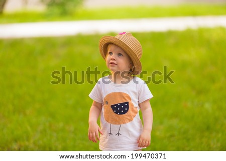 Portrait of a Cute Toddler girl in a funny hat at park background - stock photo