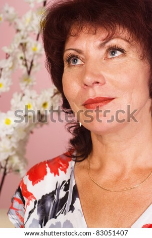 portrait of a cute woman at sofa - stock photo