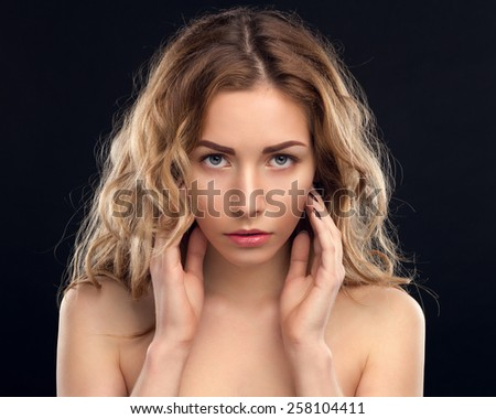 Portrait Of A Cute Woman On A Black Background - stock photo