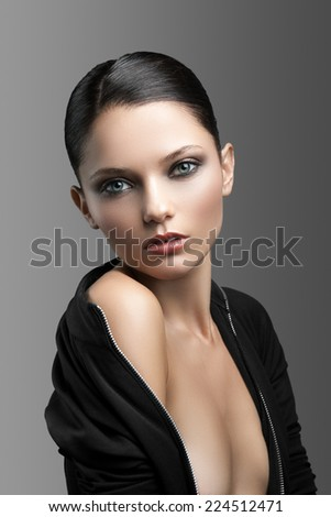 Portrait of a cute woman on a gray background - stock photo
