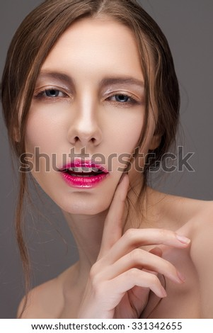Portrait Of A Cute Woman On A Gray Background