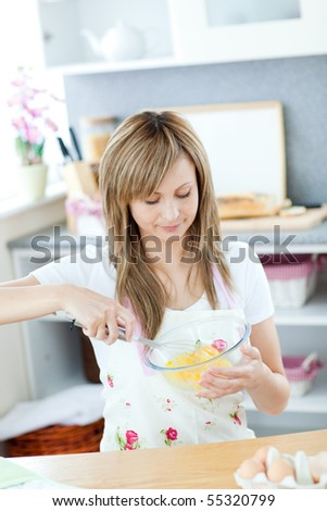 Portrait of a cute woman preparing a cake in the kitchen at home