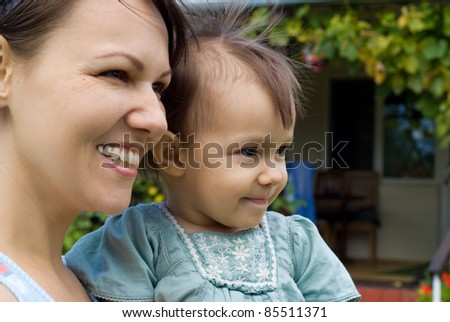 portrait of a cute woman with daughter