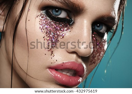 Portrait Of A Cute Woman With Fashion Makeup On A Blue Background